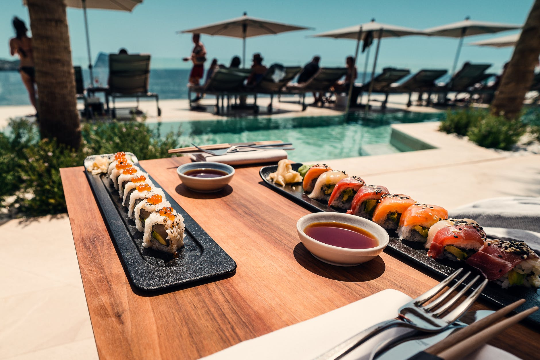 sushi roll on tray and table